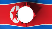 Hole cut in the flag of North Korea