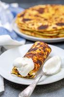 Norwegian potato pancakes lefse with sour cream.