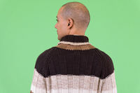 Rear view of bald multi ethnic man ready for winter