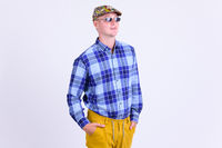 Young handsome hipster man with sunglasses thinking