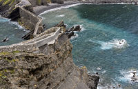 Stone bridge and cliff trail above the Bay of Biscaya,islet of San Juan de Gaztelugatxe,Spain