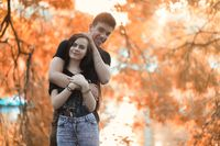 Young couple on a walk in autumn park