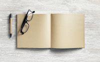 Notepad, pen, glasses