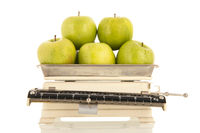 Green apples on weight scale