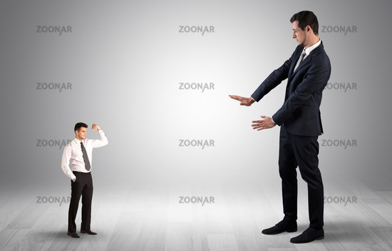 Giant businessman scared of small businessman