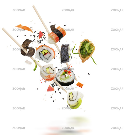 sushi rolls with wooden chopsticks on white background