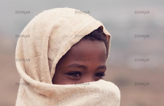 Beautiful Ethiopian girl hiding her face