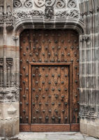 Old wooden door in a medieval building
