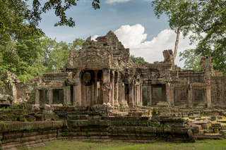 Facade of Preah Khan framed by trees