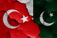 flags of Turkey and Pakistan painted on cracked wall