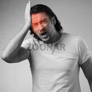 Man suffering from acute headache