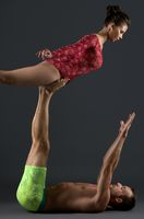 Young couple in sports clothes exercise in studio