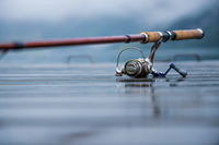 Fishing rod spinning blurred background