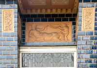 Jewellery yard with blue tiles and terracotta reliefs