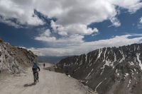 LADAKH, INDIA, August 2012, Cyclist at Khardungla Pass the highest motor road in the world