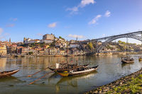 Porto Portugal city skyline at Porto Ribeira and Douro River with Rabelo wine boat and Dom Luis I Br