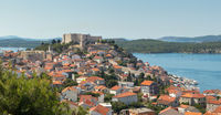 Historic city centre of Sibenik, Croatia with St. Michael's Fortress. Adriatic Sea in the background