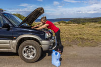 Woman fixing her broken down car 4wd