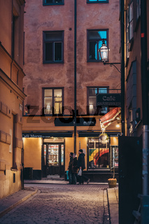 Stockholm Sweden People walking on the narrow streets of the old part of city at evening