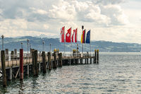 Lake Constance with flag and pier, Germany and pier, Germany