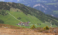 View of the village Obermutten. Early summer in the Swiss Alps.