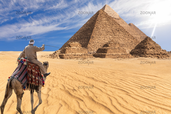 A bedouin of Giza desert in front of the Great Pyramids, Egypt