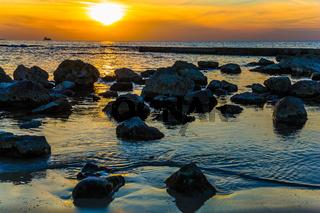 Large stones on bright sunset