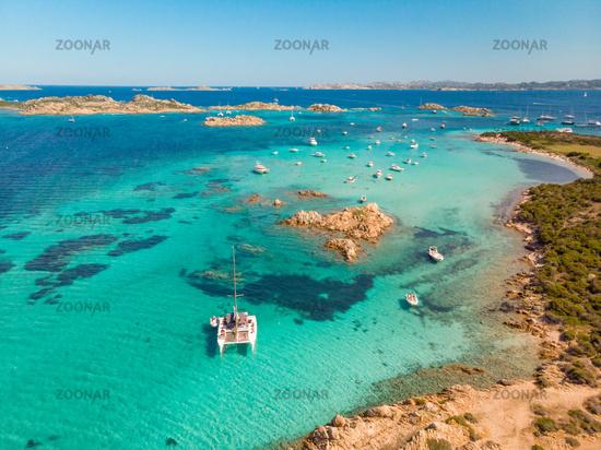 Drone aerial view of catamaran sailing boat in Maddalena Archipelago, Sardinia, Italy.