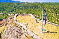 Knin fortress plateau nad large croatian flag aerial view,