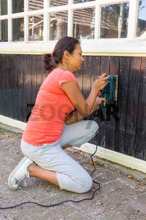 Young woman sheds wood of house