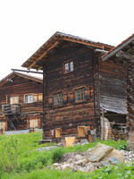 Old timber houses in Obermutten, Canton of Grisons, Switzerland.
