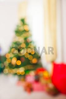 Blurred defocused lights background of Christmas decorated room