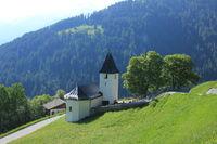 Church and trees in Mutten, Switzerland.