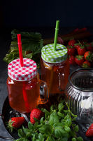 a fruit lemonade with strawberries rhubarb and mint