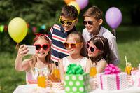 happy kids taking selfie on birthday party