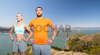 happy couple doing sports over golden gate bridge
