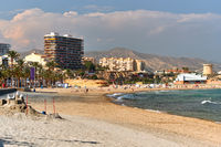 Sandy beach and cityscape El Campello. Alicante, Spain