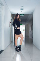 Indoor fashion portrait of young beautful slim woman