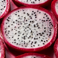 Close-up view of background from round slices of Dragon fruit or Pitaya on a pink background.