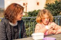 Woman with child picnic on castle Scharfenstein