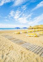 umbrellas and beach chairs at deserted beach in pre-season