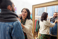 couple choosing clothes at vintage clothing store