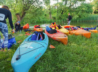 kayaks on the river shore, tourists are preparing for rafting on canoe