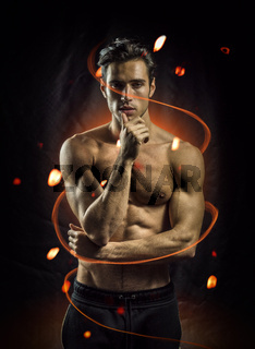 Handsome muscular man in flame