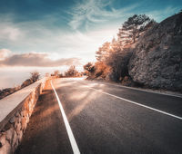 Mountain road and beautiful sky at sunset in autumn