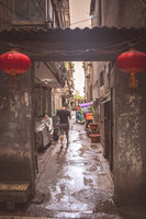 Man walking on a narrow street in Xian Old Town
