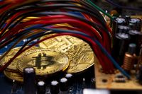 Bitcoin coins, colorful cables and printed circuit board PCB