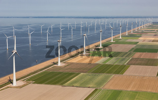 Aerial view Dutch landscape with offshore wind turbines along coast