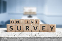 Online survey sign on a table in a blue room