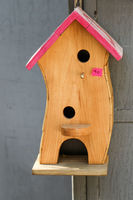 Wooden bird house with holes